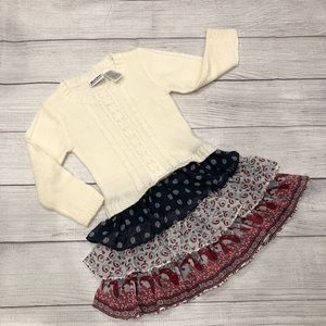Adorable cable knit sweater attached ruffle skirt.